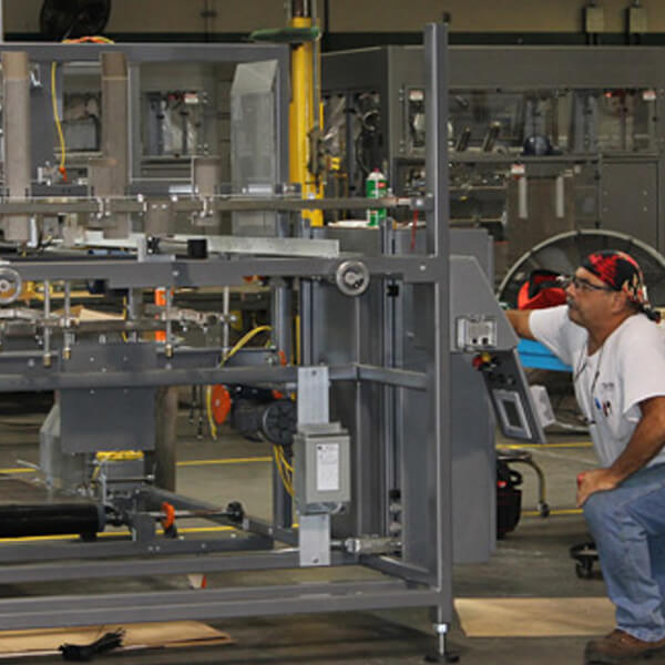 Man working at an Automated Packaging System