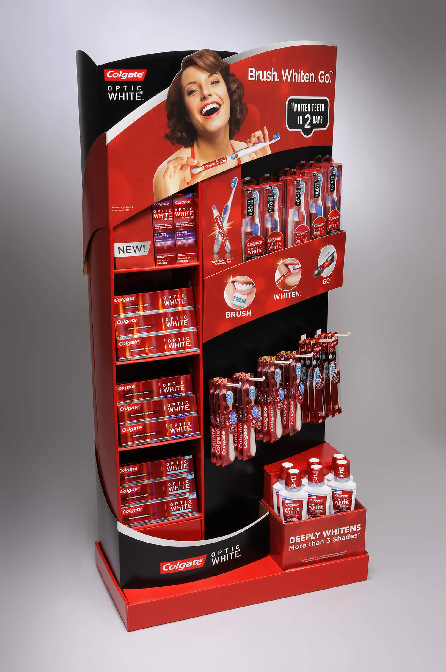 Colgate Optiwhite EC toothbrush and toothpaste retail product display.