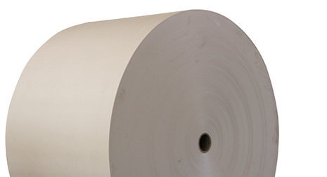 A roll of white containerboard.