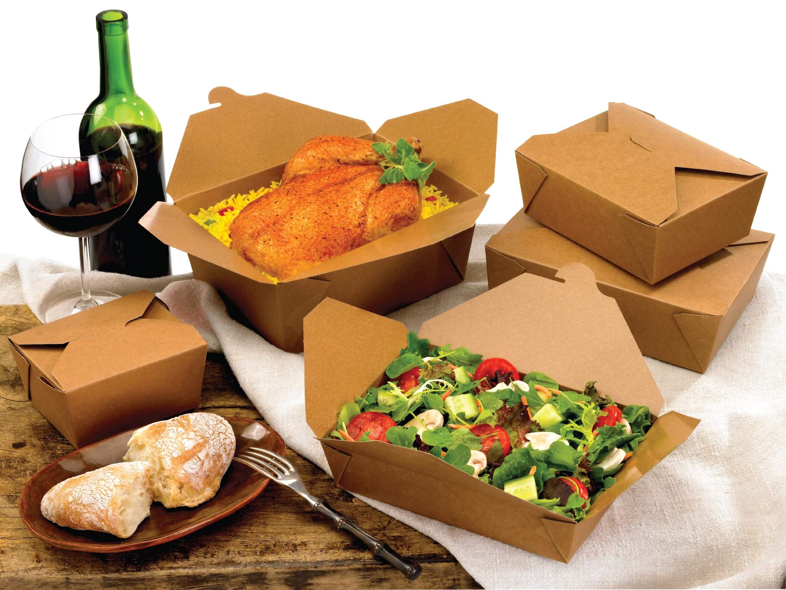 A group shot of Bio-Plus Terra II folding carton containers holding chicken and salad.