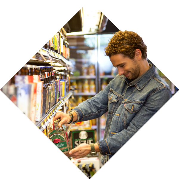 man shopping for beer